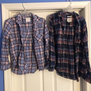 Two American Eagle flannels